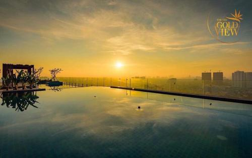 The swimming pool at or near LUXURY GOLD APARTMENT 5 - Rooftop Pool City View In the HEART HCM 1207