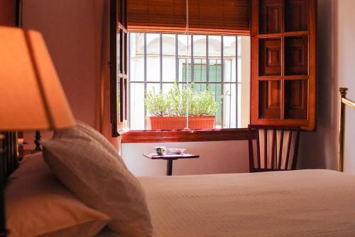 Cama o camas de una habitación en Casa rural Llana 12