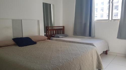 A bed or beds in a room at No coração de Copacabana