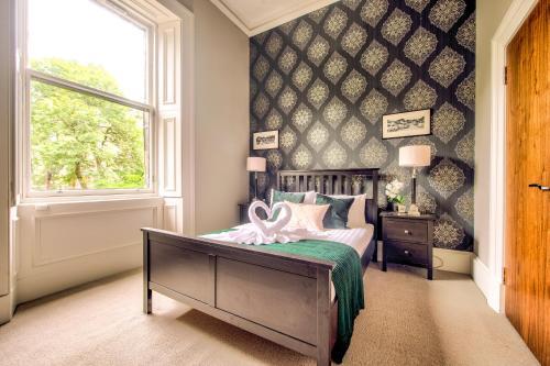 Ein Bett oder Betten in einem Zimmer der Unterkunft 32 Victoria Crescent Road