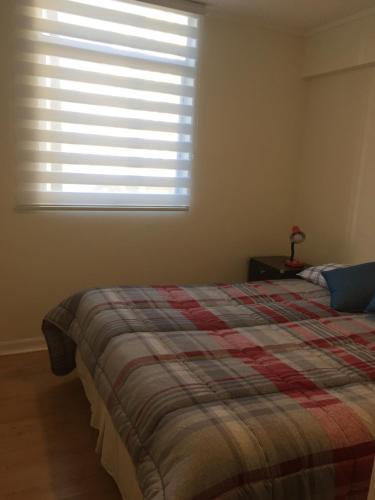Cama o camas de una habitación en Patagonia Apartment