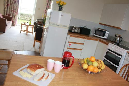 A kitchen or kitchenette at Giant's Causeway Holiday Cottages
