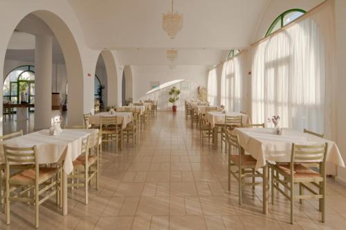 Een restaurant of ander eetgelegenheid bij Alexandra Beach