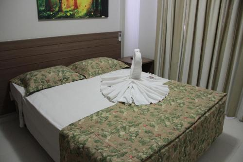 A bed or beds in a room at Veredas do Rio Quente Flat