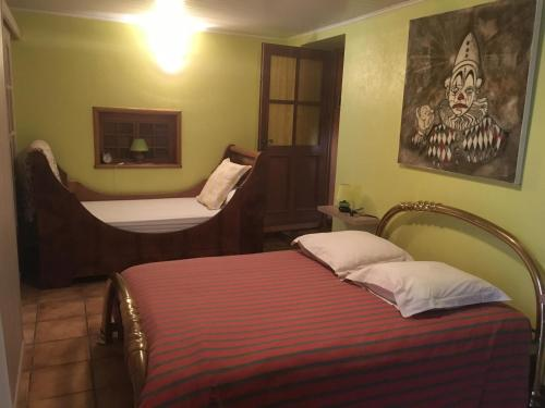 Un ou plusieurs lits dans un hébergement de l'établissement Gite S'Hiesla