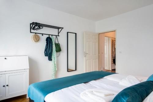 A bed or beds in a room at Dositejeva Urban Downtown Apartment
