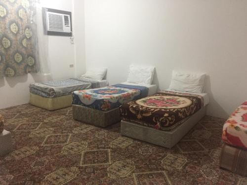 A seating area at Jar Al Habib Suites
