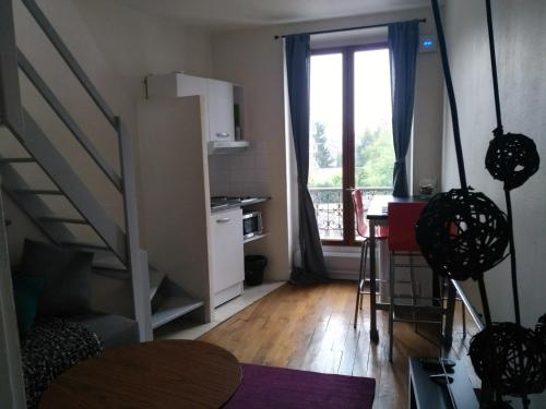 A seating area at Charming Parisian studio!