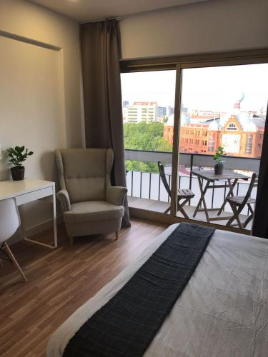 A seating area at Republica83-Campo Pequeno Home