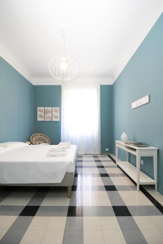 A bed or beds in a room at Be Apartments Città Studi