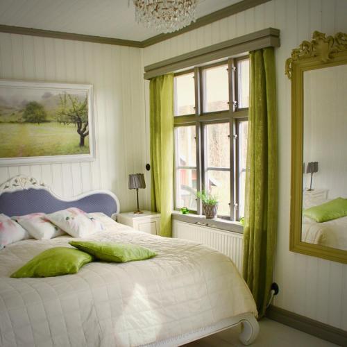 Säng eller sängar i ett rum på Ranebo Bed & Breakfast