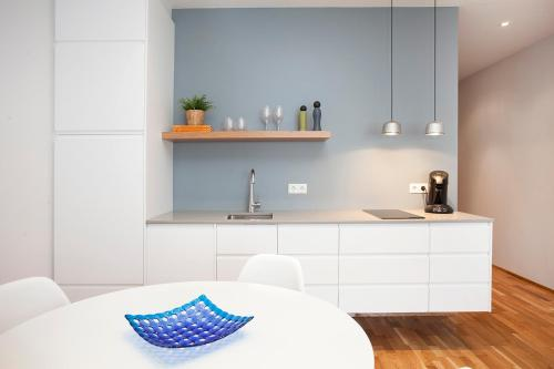 A kitchen or kitchenette at V54 Harbour Apartments