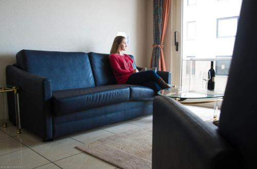 A seating area at Top Apartment Ostend