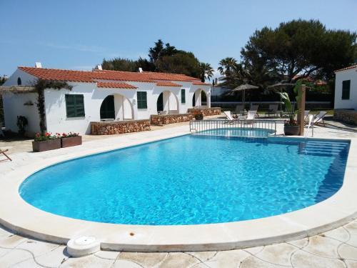 The swimming pool at or near Nure Cel Blau