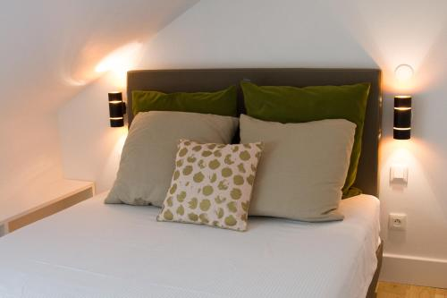 Un ou plusieurs lits dans un hébergement de l'établissement Studio au charme authentique