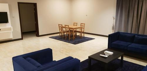 A seating area at The New Address Furnished Apartments