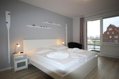 Ein Bett oder Betten in einem Zimmer der Unterkunft Lagunenstadt am Haff