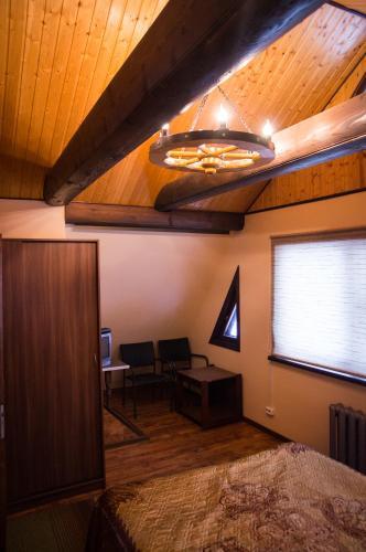 A television and/or entertainment center at Guest House at Semenovskaya