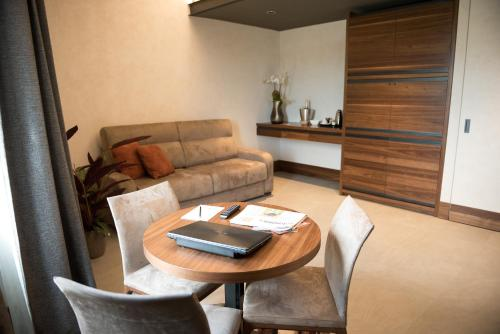 A seating area at Gasometer Urban Suites