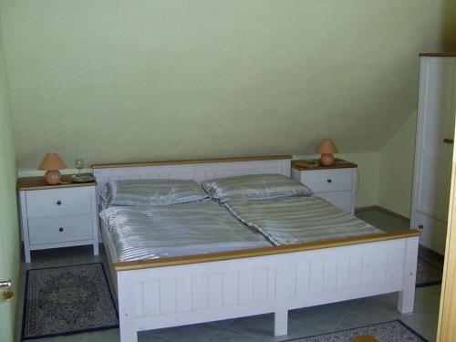 A bed or beds in a room at Penzion Rozalie