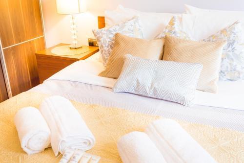 Gulta vai gultas numurā naktsmītnē Dockside Walk Suite - Canary Wharf
