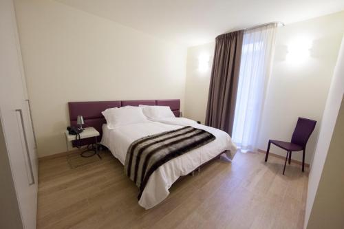 Voodi või voodid majutusasutuse Residenza Agnello D'Oro toas
