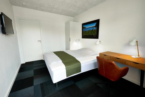 En eller flere senge i et værelse på Giestgivergaarden Phønix