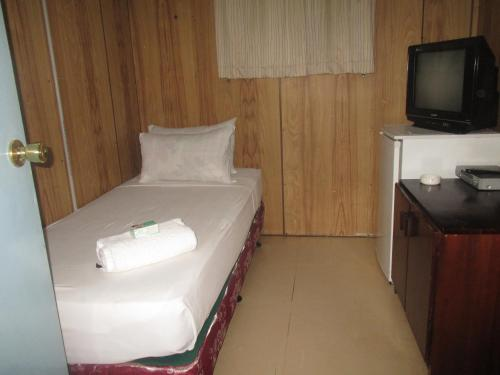 A bed or beds in a room at Hohola Apartments