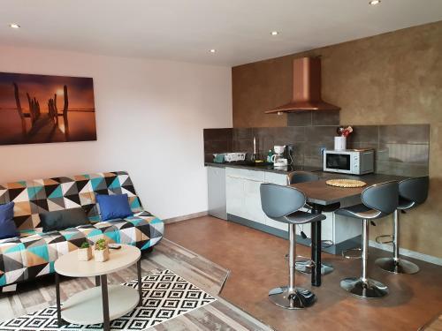 A kitchen or kitchenette at Les Lofts du Parc