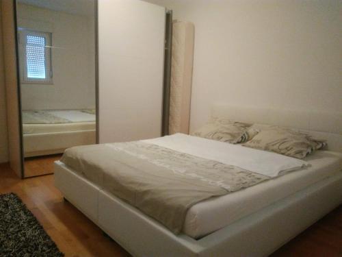 Postel nebo postele na pokoji v ubytování Apartment Iris