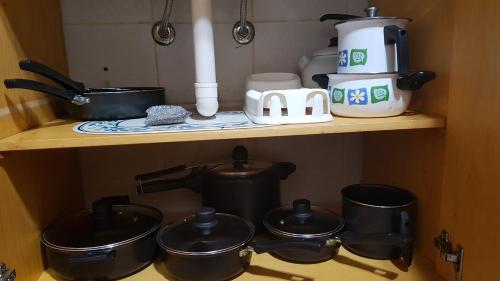 Coffee and tea making facilities at Aconchegante apto Natal Luz