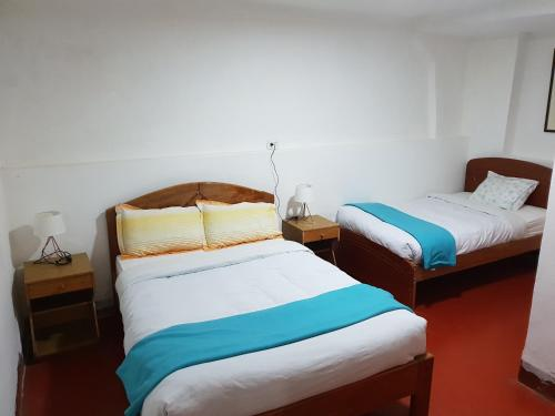 Cama o camas de una habitación en Casa Saphy - Plaza de Armas