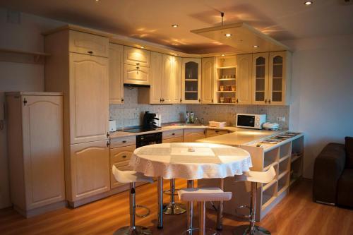 A kitchen or kitchenette at Asztro Apartman