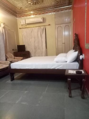 A bed or beds in a room at Hotel Shubh Ashirwad