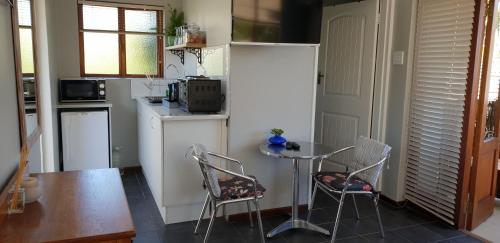A kitchen or kitchenette at Cobie Apartment