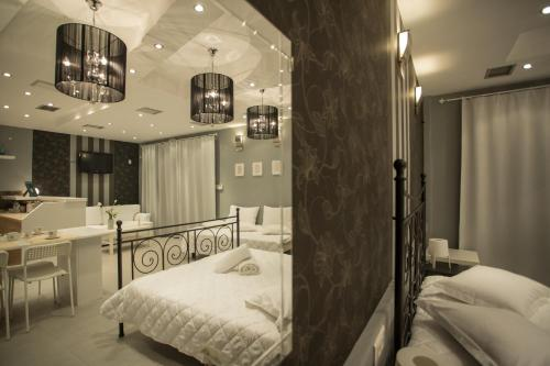 A bed or beds in a room at Apollonio Rooms