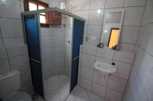Um banheiro em Flats Praia do Paiva