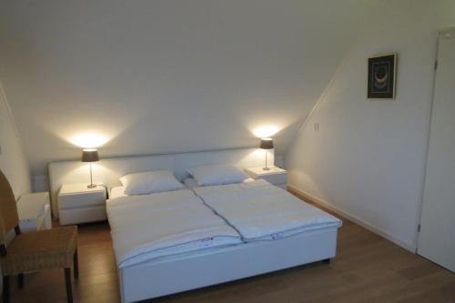 Katil atau katil-katil dalam bilik di Wetterkantwoning