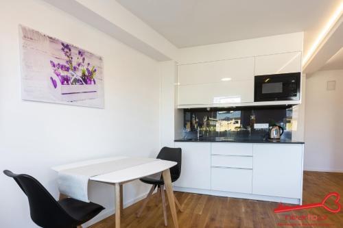 A kitchen or kitchenette at Apartment Nearto Old Town Sebastiana street