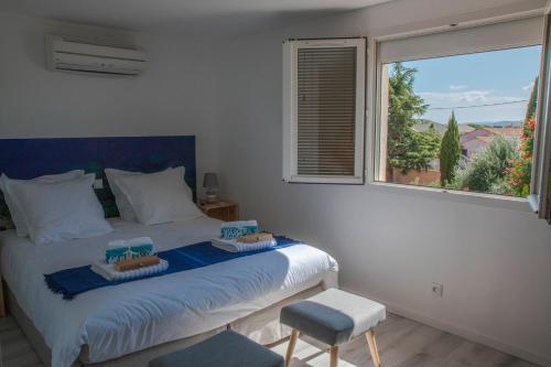 Un ou plusieurs lits dans un hébergement de l'établissement Les Gites du Somail