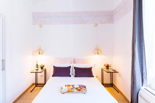 מיטה או מיטות בחדר ב-Margana Tower