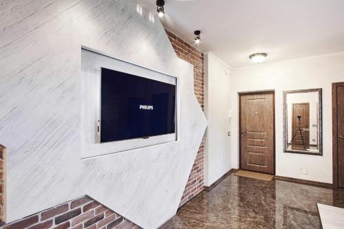 A television and/or entertainment center at Loft Apartments Platonova 33
