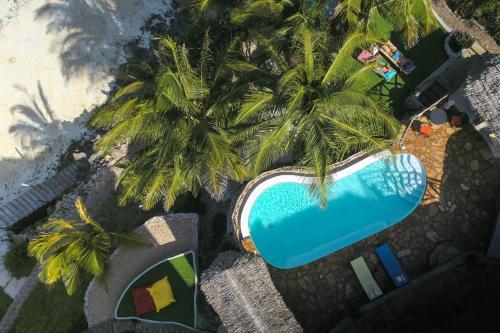 O vedere a piscinei de la sau din apropiere de Villa Fleur De Lys