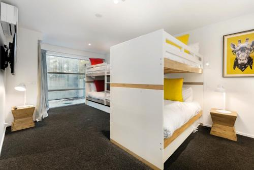 A bunk bed or bunk beds in a room at Diamond Deluxe Central Queenstown