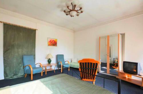 A seating area at Letniy sad Apartments