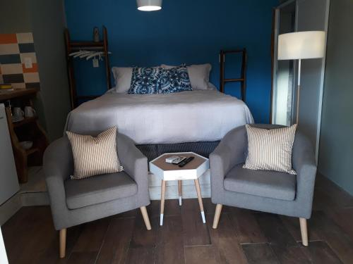 A bed or beds in a room at Il Tano Suites