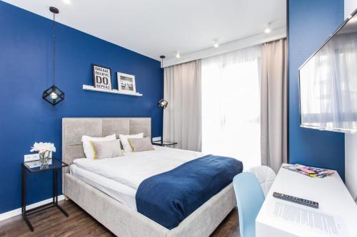 Łóżko lub łóżka w pokoju w obiekcie Modern & Classy Industrial - Apartamenty Browar Gdańsk