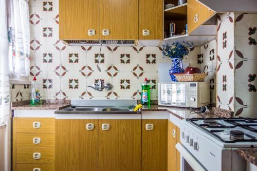 Кухня или мини-кухня в Garbinet