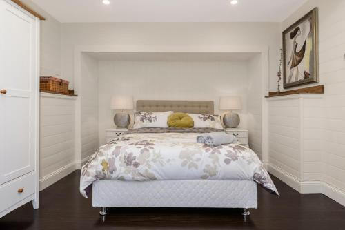 A bed or beds in a room at Olinda Forest Retreat with Spa