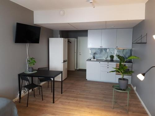 A kitchen or kitchenette at Apartments Uppsala - Portalgatan